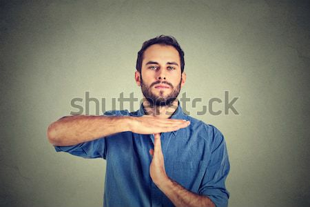 Young man giving showing time out hands gesture Stock photo © ichiosea