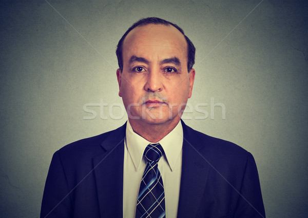 Head and shoulders shot of a middle aged business man in a suit and shirt with tie  Stock photo © ichiosea