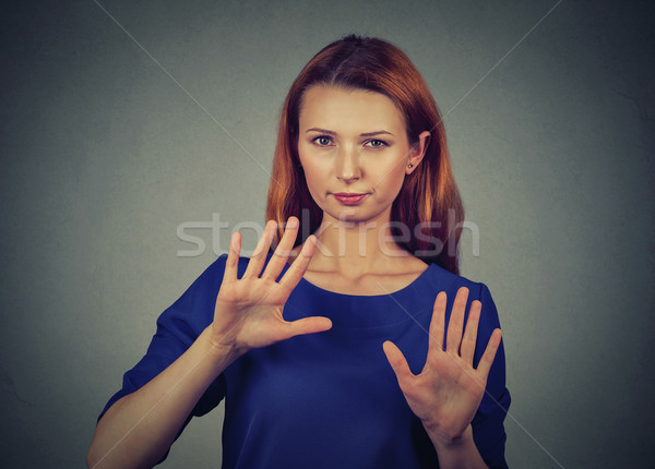 annoyed angry woman with bad attitude gesturing with palms outward to stop  Stock photo © ichiosea