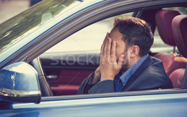 man sitting inside his car and feeling stressed and upset Stock photo © ichiosea