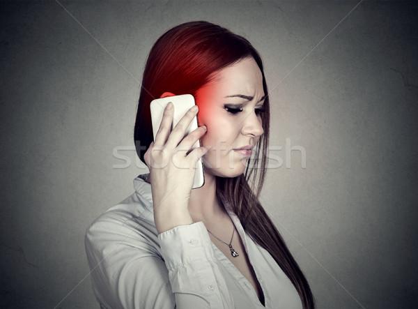 Bouleversé triste femme parler téléphone portable cellulaires Photo stock © ichiosea