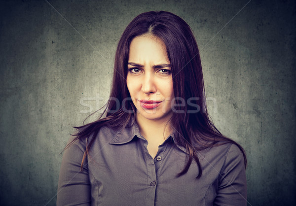 Suspicious doubtful young woman  Stock photo © ichiosea