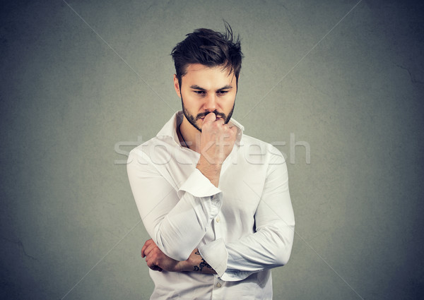 Young man considering on problem looking pensive Stock photo © ichiosea