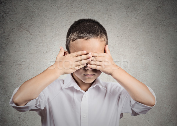 Boy covers his eyes with hands. Hear no evil concept Stock photo © ichiosea