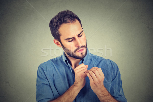 man looking at hands nails obsessing about cleanliness germs Stock photo © ichiosea