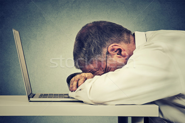 Side profile mature business man sleeping on a laptop Stock photo © ichiosea