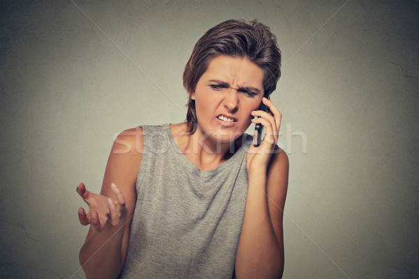 Upset skeptical, unhappy angry woman talking on phone Stock photo © ichiosea