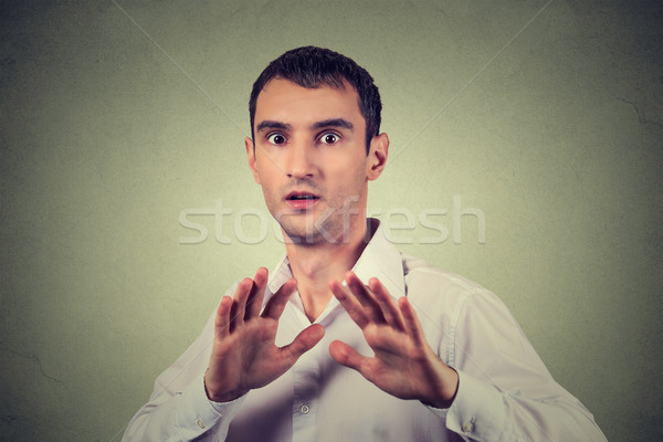 man looking shocked scared trying to protect himself from unpleasant situation Stock photo © ichiosea
