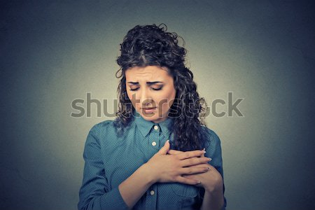 unhappy frustrated young woman surprised she is losing hair, noticed split ends Stock photo © ichiosea