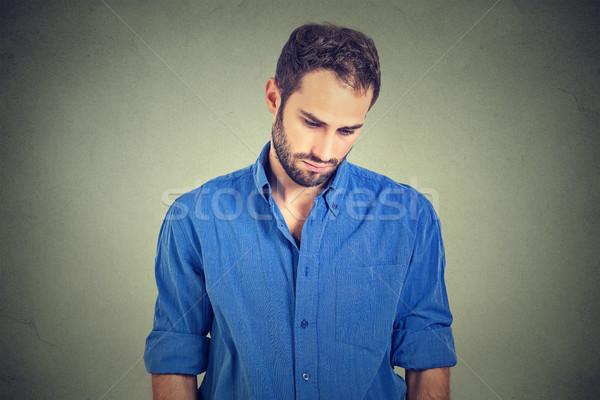 Smutne samotny młody człowiek patrząc w dół nie energii Zdjęcia stock © ichiosea