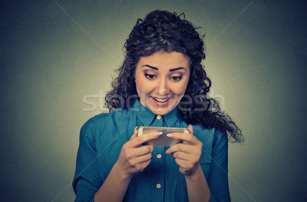 woman holding using new smartphone mobile phone connected browsing internet Stock photo © ichiosea