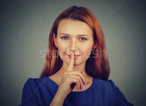 secretive young woman placing finger on lips asking shh, quiet, silence Stock photo © ichiosea