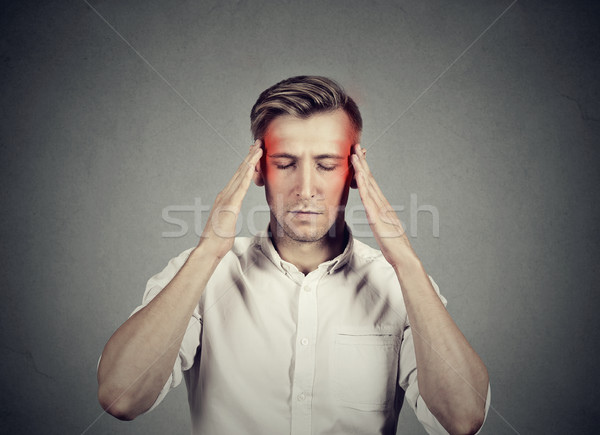 Man with headache thinking very intensely concentrating  Stock photo © ichiosea