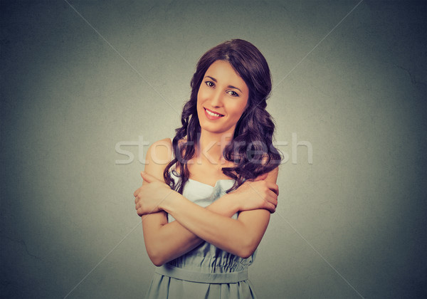 confident smiling woman holding hugging herself. Love yourself concept Stock photo © ichiosea