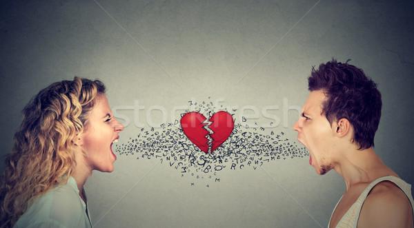 man woman screaming at each other alphabet broken heart in-between Stock photo © ichiosea