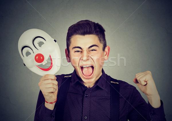 Zaklatott mérges sikít férfi tart bohóc Stock fotó © ichiosea