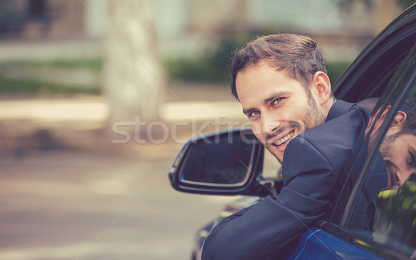happy smiling young man buyer sitting in his new car Stock photo © ichiosea