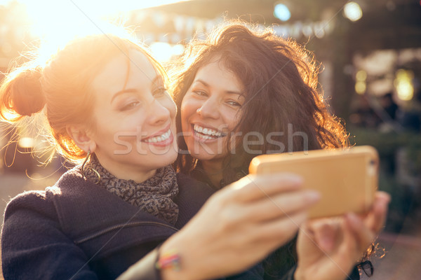 Female friends two women taking selfie during weekend getaway Outdoors Stock photo © ichiosea