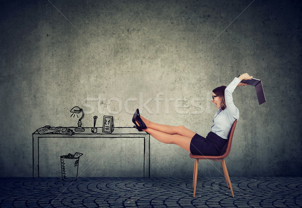 Frustrated business woman sitting at her desk mad with her unreliable laptop Stock photo © ichiosea