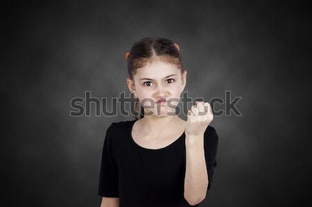 Enojado nina puno alguien primer plano Foto stock © ichiosea