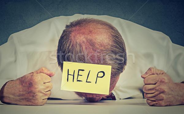 Tired, stressed senior employee needs help Stock photo © ichiosea