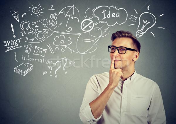 happy man thinking dreaming has many ideas looking up Stock photo © ichiosea