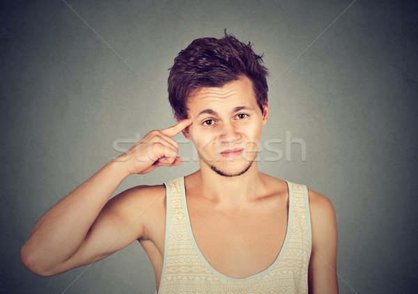 angry mad young man gesturing with finger are you crazy?  Stock photo © ichiosea