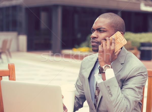 üzletember dolgozik laptop kint beszél mobiltelefon Stock fotó © ichiosea