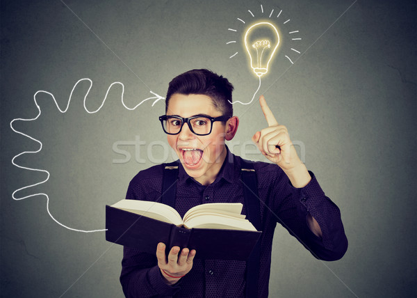 Amazed man in glasses reading book comes up with an idea Stock photo © ichiosea