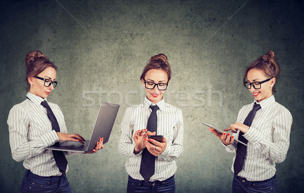 Happy woman working using multiple devices Stock photo © ichiosea