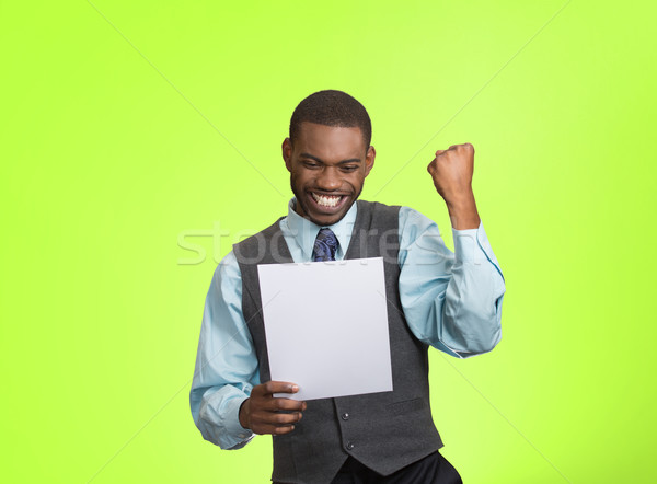 Excited happy man holding document, receiving goood news Stock photo © ichiosea