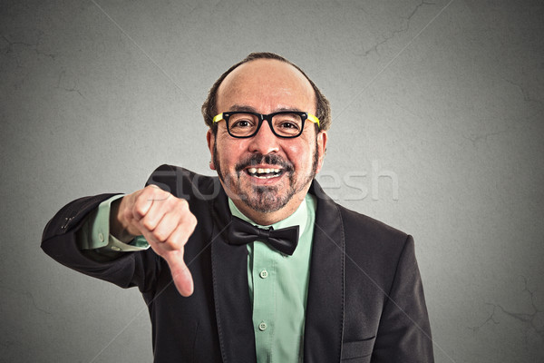 Happy man showing thumbs down hand gesture  Stock photo © ichiosea