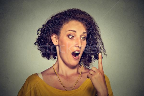 şaşırmış kadın bakıyor işaret parmağı yüz Stok fotoğraf © ichiosea