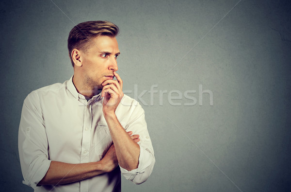 Preoccupied anxious young man Stock photo © ichiosea