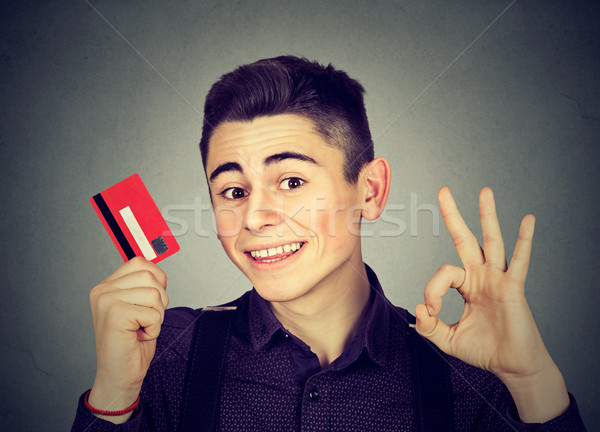 happy young man with credit card showing Ok sign  Stock photo © ichiosea