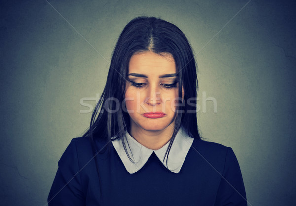 Portrait of a sad woman looking down  Stock photo © ichiosea