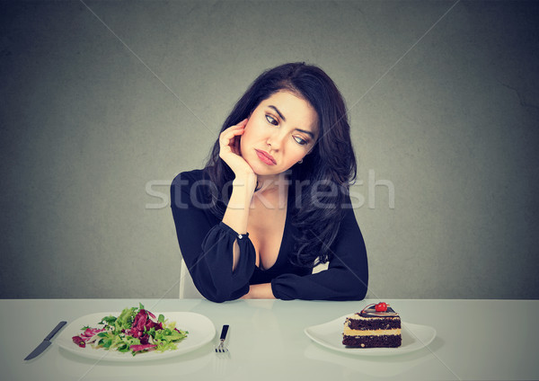 Woman craving for sweet dessert Stock photo © ichiosea