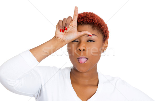 Woman giving loser sign on forehead Stock photo © ichiosea