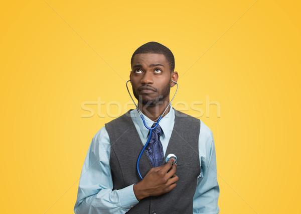 Executive man listening  to his heart, self criticism concept Stock photo © ichiosea