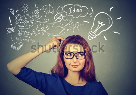 woman thinking dreaming has many ideas looking up Stock photo © ichiosea