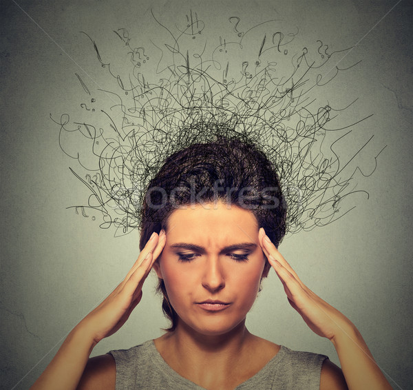 woman with worried stressed face expression frowning and brain melting into lines  Stock photo © ichiosea