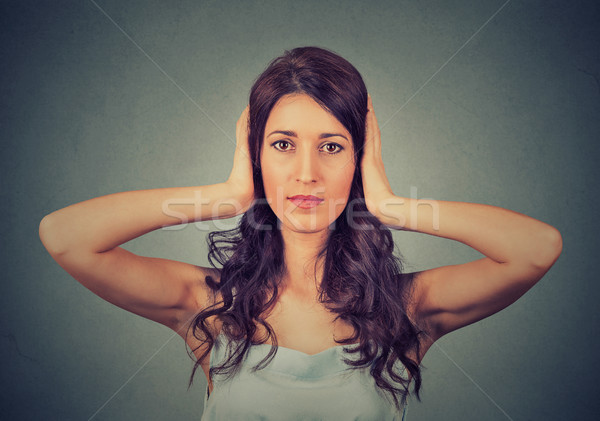 young attractive woman covering with hands her ears closed. Hear no evil concept Stock photo © ichiosea