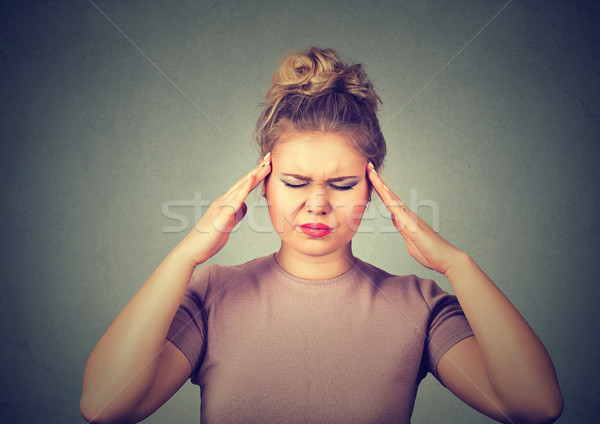 sad young woman with worried stressed face expression looking down trying to concentrate isolated on Stock photo © ichiosea