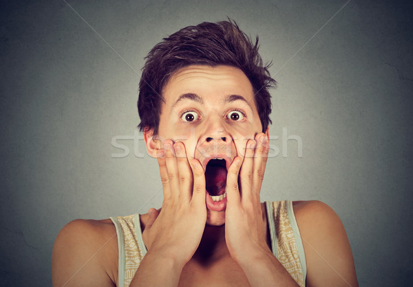 shocked surprised man in disbelief with hands on face screaming  Stock photo © ichiosea
