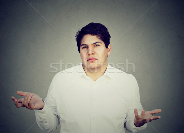 unsure confused man shrugging shoulders  Stock photo © ichiosea