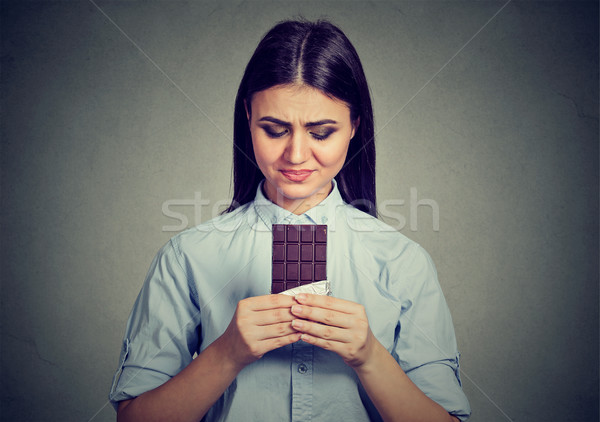 woman tired of diet restrictions craving sweets chocolate bar  Stock photo © ichiosea