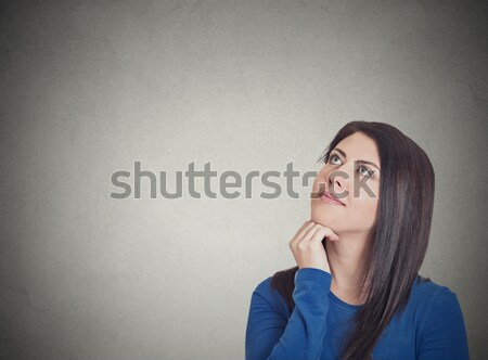 Stock photo: Smiling woman thinking