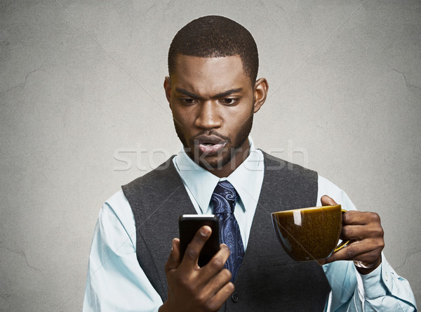 Serious business man texting on his phone Stock photo © ichiosea