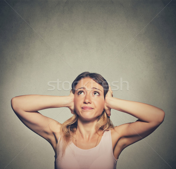 unhappy woman covering her ears looking up stop making loud noise Stock photo © ichiosea