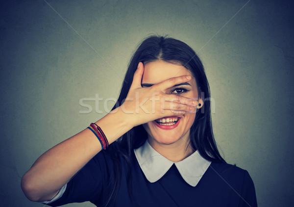 Happy woman peeping at you Stock photo © ichiosea
